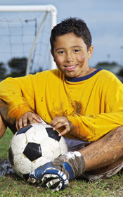Child sitting on soccer field